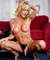 Red couch Seductive TS babe Olivia Love posing her considerable tits and cock.