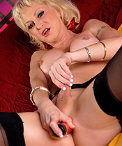 Olivia toys on her bed. Blonde shemale Olivia Love toying her